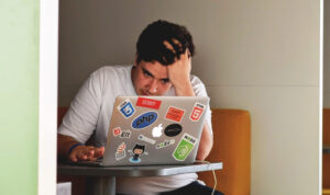 A man sitting at his desk frustrated
