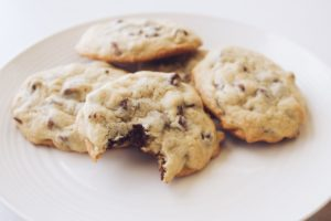 A plate of chocolate-chip cookies